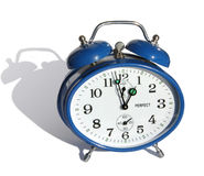 Alarm clock. Blue alarm clock on a white background Royalty Free Stock Photos