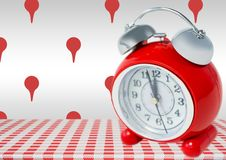 Alarm Clock against grey background with location marker icons Stock Photo