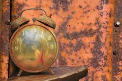 Alarm clock against orange. stock images