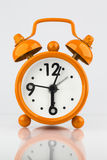 Alarm clock against white background. Glossy alarm clock against white background Royalty Free Stock Photos