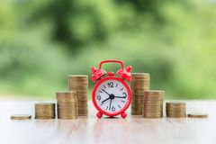 Free Alarm Clock And Step Of Coins Stacks On Working Table.  Banking And Business Idea. Time For Savings Money Concept Stock Image - 157808051