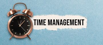 Free Alarm Clock And Torn Paper Revealing The Words TIME MANAGEMENT Royalty Free Stock Image - 191082426