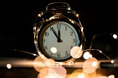 Alarm clock in anticipation of the holiday stock photography