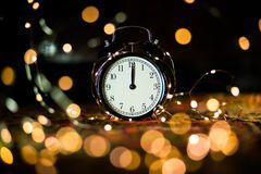 Alarm clock in anticipation of the holiday stock image