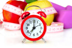 Alarm clock, apple and dumbbell isolated Stock Image