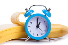 Alarm clock and banana Royalty Free Stock Images