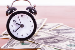 Alarm Clock and Banknotes Royalty Free Stock Image