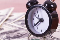 Alarm Clock and Banknotes Stock Photo