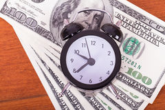 Alarm Clock and Banknotes Stock Photography
