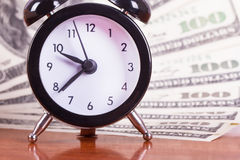 Alarm Clock and Banknotes Royalty Free Stock Images