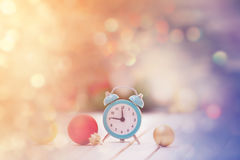 Alarm clock and baubles. With christmas gifts on background Royalty Free Stock Photos