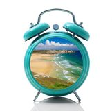 Alarm clock with beach dial on white background Royalty Free Stock Photos