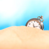 Alarm clock on the beach Stock Image