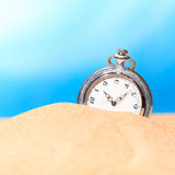 Alarm clock on the beach Stock Photo