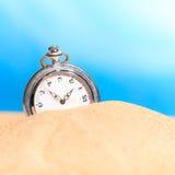 Alarm clock on the beach Royalty Free Stock Image