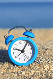 Alarm clock on the beach Royalty Free Stock Photos