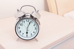 Alarm clock and bed Royalty Free Stock Photo