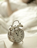 Alarm clock in bedroom Royalty Free Stock Image