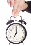 Alarm clock being held by woman's hand. Royalty Free Stock Photos
