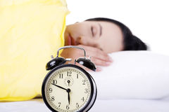 Alarm clock being placed on a nightstand Stock Photography