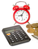 Alarm clock with bills and coins Stock Images