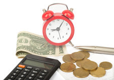 Alarm clock with bills and money Royalty Free Stock Photo