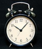 Alarm clock on black Stock Photos