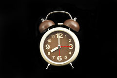 Alarm clock on black Royalty Free Stock Photography