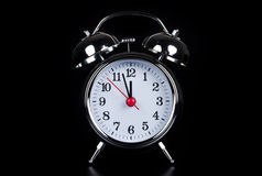Alarm clock before black royalty free stock image