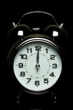Alarm clock on black background Royalty Free Stock Photography