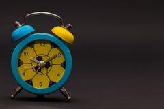 Alarm clock on black background. Royalty Free Stock Photos