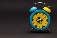 Alarm clock on black background. Stock Images