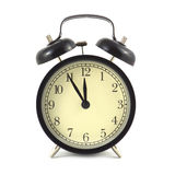 Alarm clock in black case and beige clockface isolated close up Royalty Free Stock Photos