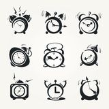 Alarm clock black icons Stock Photos