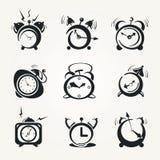 Alarm clock black icons. Stylized icons alarm clock  (hours Stock Photos