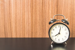 Alarm clock on Black table Royalty Free Stock Images
