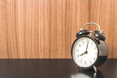 Alarm clock on Black table Stock Photo