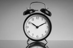 Alarm Clock on black and white background with selective focus and crop fragment. Business and Copy space concept stock image