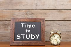 Alarm clock and blackboard with text `Time to study`` stock photo