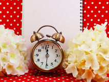 Alarm clock and blank notebook with space for copy background Royalty Free Stock Images