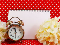 Alarm clock and blank notebook with space for copy background Stock Image
