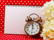 Alarm clock and blank notebook with space for copy background Royalty Free Stock Image