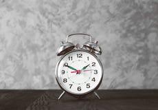Alarm clock on blask wooden table Royalty Free Stock Image