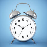 Alarm clock on blue background Stock Images