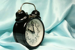 Alarm-clock on blue background Royalty Free Stock Images