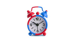 Alarm clock in blue and red Royalty Free Stock Photography