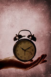 Alarm clock on palm of hand Royalty Free Stock Photo