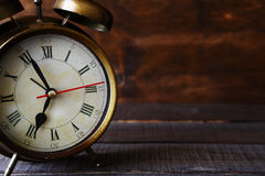 Alarm clock on the boards Stock Photography