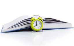 Alarm clock and book. Alarm clock in front of the book as concept for studying Royalty Free Stock Photos