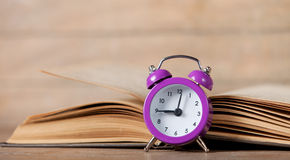 Alarm clock and book Royalty Free Stock Image